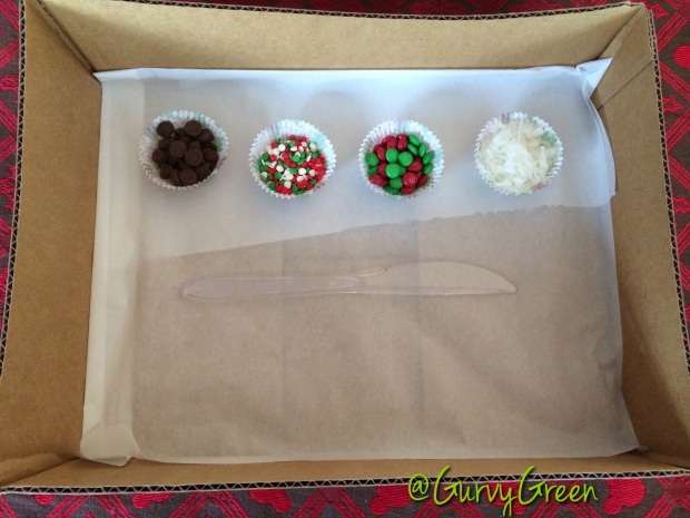 Place your sprinkles, and a plastic knife inside each decorator's box
